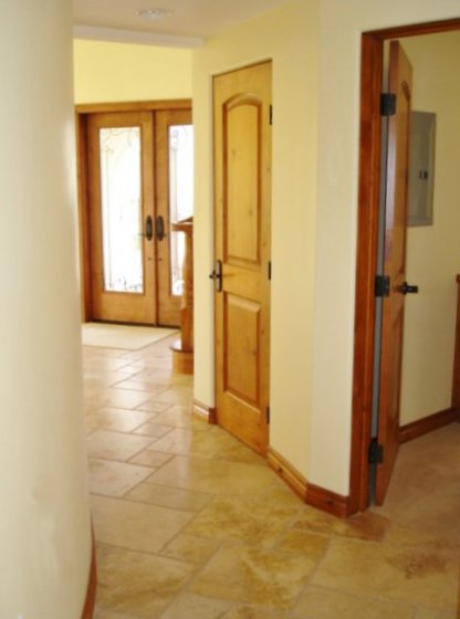 Solid Raised Panel Doors In Hallway