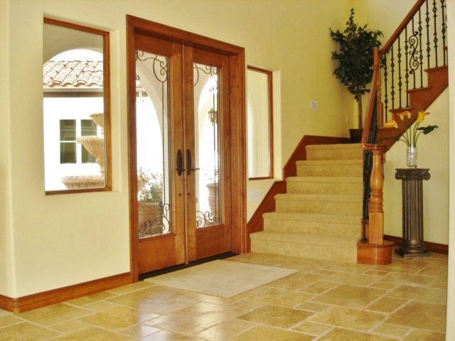 Foyer With Travertine Floor & Wrought Iron Railing