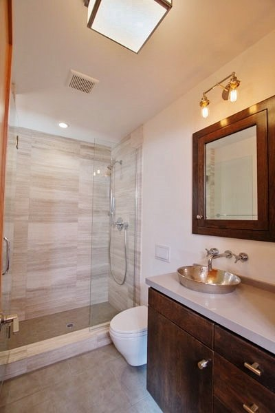 Stone Shower With Basin And Modern Fixtures
