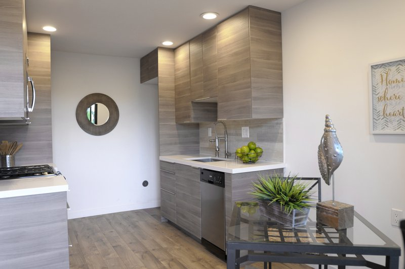 Contemporary Kitchen With Caesarstone Countertops